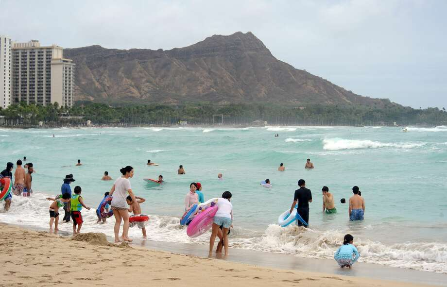 Waikiki Beach near Diamond Head Crater is seen in this August 2018 file photo. A California man was arrested Saturday May 16, 2020, after he allegedly posted a video of himself breaking Hawaii's 14-day quarantine order on YouTube. Diamond Head was reportedly one of the locations he visited. Photo: RONEN ZILBERMAN/AFP/Getty Images