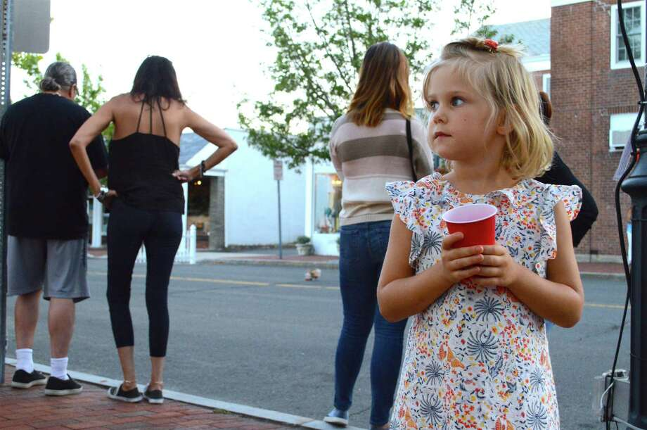 Anna Makar, 4, of New Canaan, stops for a drink at the Taste of the Town Stroll, Thursday, Aug. 23, 2018, in downtown New Canaan, Conn. Photo: Jarret Liotta / For Hearst Connecticut Media / New Canaan News Freelance