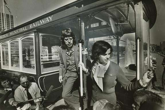October 20, 1981- Mayor Feinstein and Mick Jagger on cable car in San Francisco for Save The Cable Cars Promo.  Steve Ringman/The Chronicle