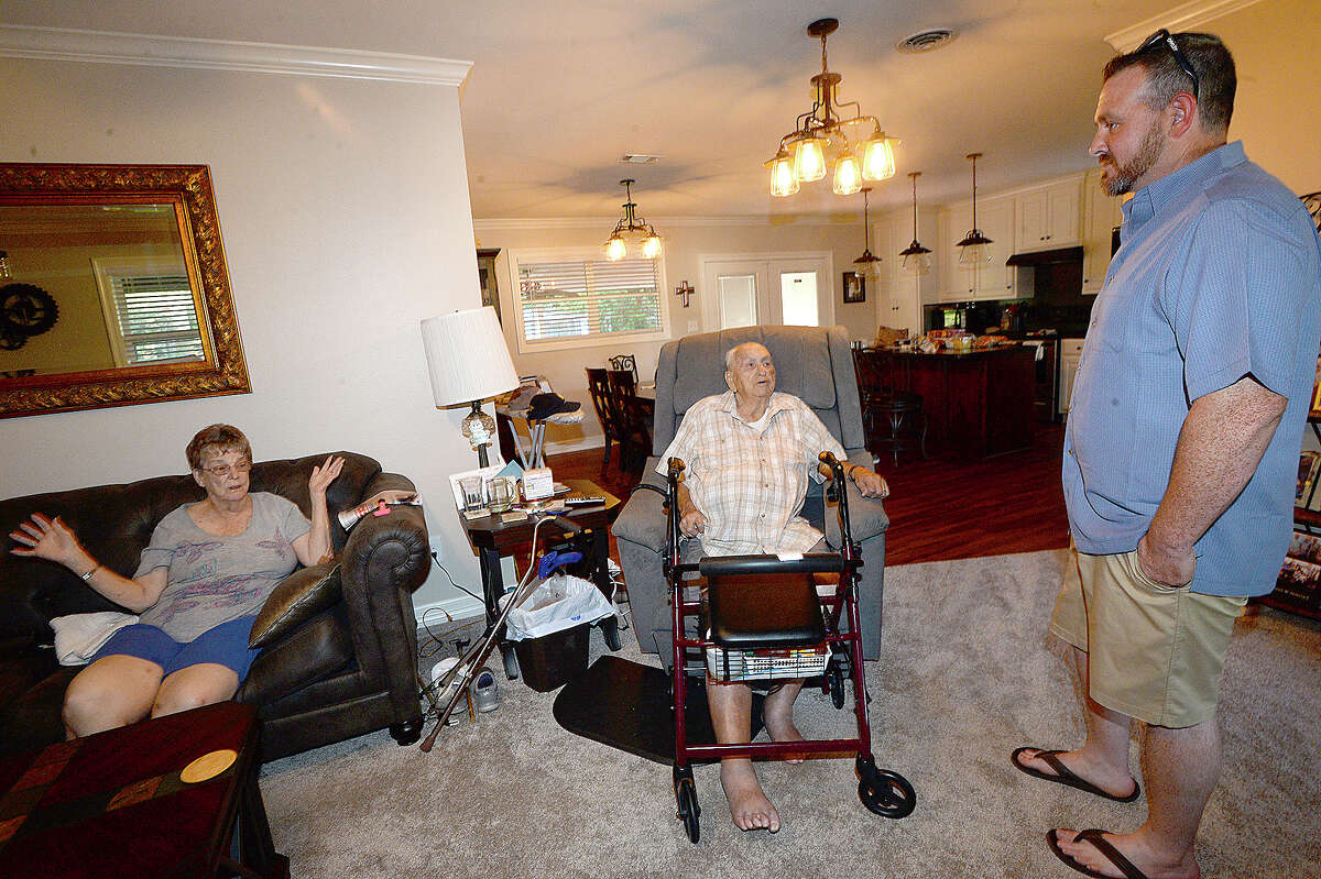Travis Cloudy visits with Phyllis and Max Odom, who were among the more than 60 people he rescued during Harvey's flooding. Cloudy went out in his flat bottom boat as the flooding from Tropical Storm Harvey worsened, working hours Tuesday and Wednesday rescuing families from their homes. Friday, August 17, 2018 Kim Brent/The Enterprise