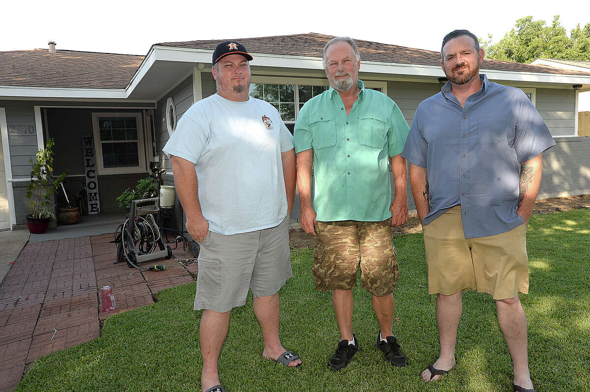 Travis Cloudy (right) went out in his flat bottom boat as the flooding from Tropical Storm Harvey worsened, working hours Tuesday and Wednesday rescuing families from their homes. Brian Linthicum (left) contacted Cloudy to try and get his father David Linthicum, who had refused to leave his home on Oleander in Groves. David was the final rescue Cloudy performed around 2 a.m. Wednesday, before weather conditions became too difficult to continue. Friday, August 17, 2018 Kim Brent/The Enterprise