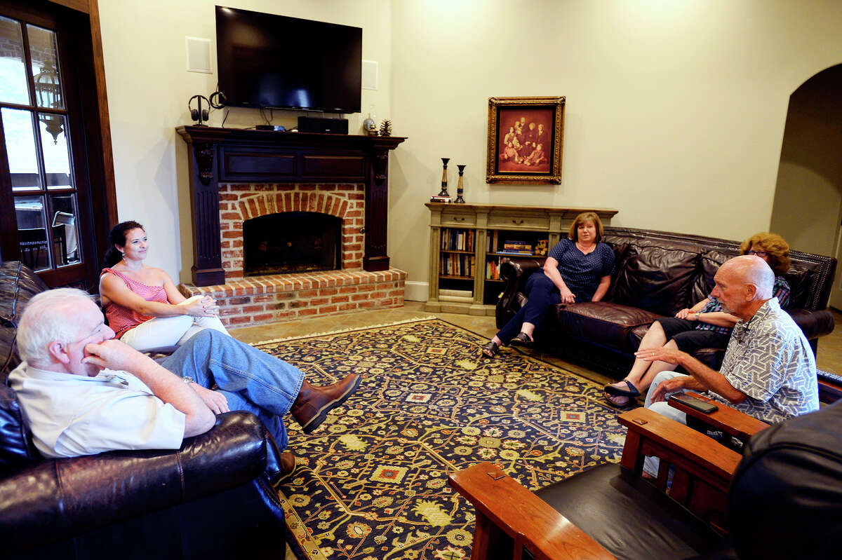 Jerry Davis, right, talks with his daughter, Joanna Edgeworth, left, Alan Thornton, Pam Thornton, center, and his wife, Joann, in the living room of his Plantation Oaks home. The Davis residence became home for 21 people, including two families of strangers, after Tropical Storm Harvey flooded nearby Keith Road. Photo taken Thursday 8/9/18 Ryan Pelham/The Enterprise