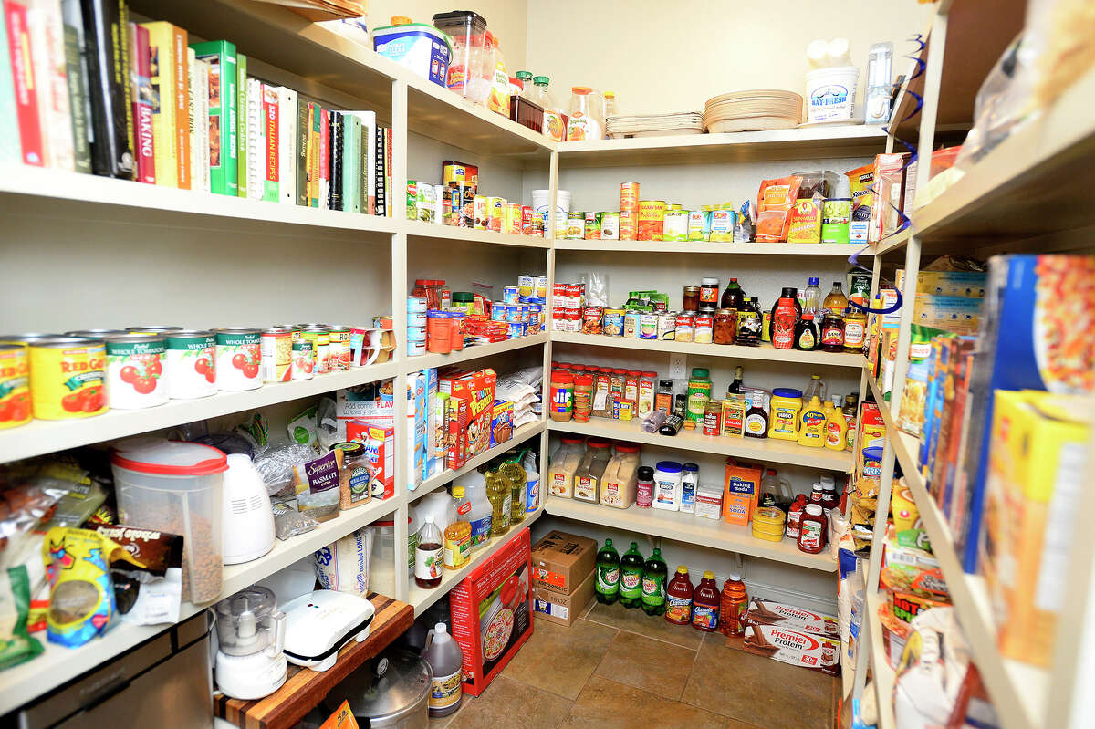 Jerry and Joann Davis keep a large pantry stocked with food year-round, which enabled them to feed all 21 people who stayed at their home during Tropical Storm Harvey. As the only ones on their block with a whole house generator, the Davis residence became a gathering point for neighbors looking for hot coffee every morning. Photo taken Thursday 8/9/18 Ryan Pelham/The Enterprise