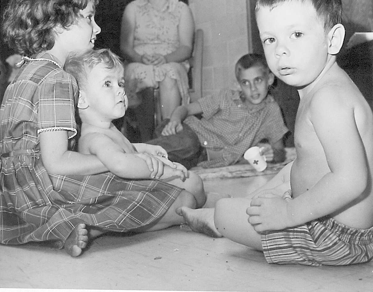 Debbie Owner, 6, holds her brother Dave, 1, as Billy, 2, stares into the camera at a Port Arthur Junior High. Photo taken September 1961 Enterprise archive photo