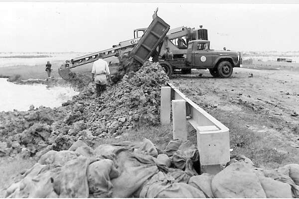 Workers fill in a drainage ditch on Highway 73. Photo taken September 1961 Enterprise archive photo