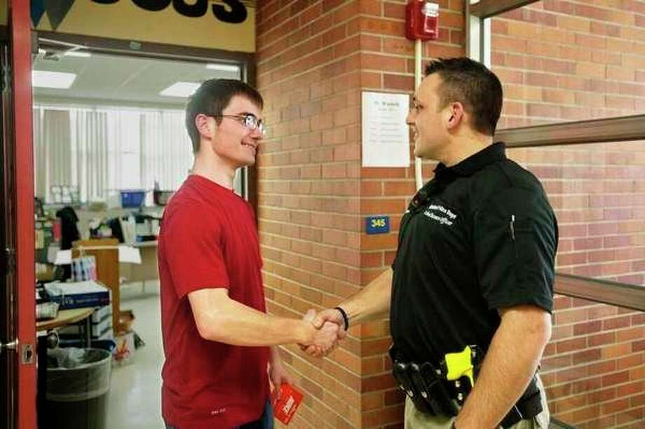 Eddie Hinson, right, is the school resource officer at Midland High School. (Daily News file photo)