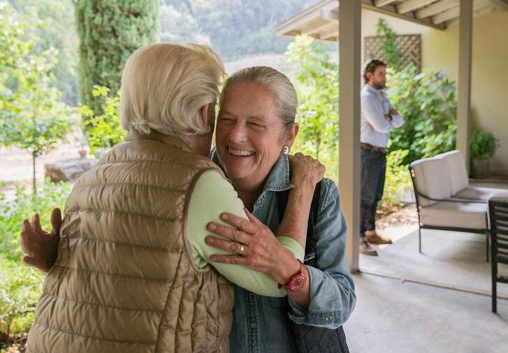 Current Stony Hill Vineyard owner Willinda McCrea, left, greets future owner Laddie Hall at Stony Hill Vineyard in Calistoga, Calif. Tuesday, Aug. 21, 2018.