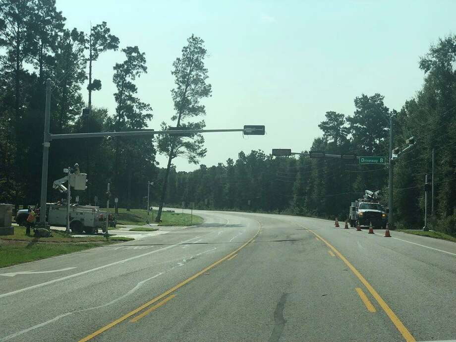 The Texas Department of Transportation works to ensure everything is in place to make the traffic light on FM 2090 operational. Photo: Courtesy Of Splendora ISD