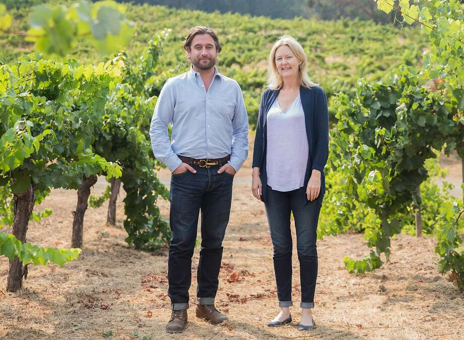 Chris Hall and Sarah McCrea stand among the old vines at Stony Hill Vineyard. Hall's family, which also owns Long Meadow Ranch, has purchased Stony Hill from the McCrea family. Photo: Jessica Christian / The Chronicle