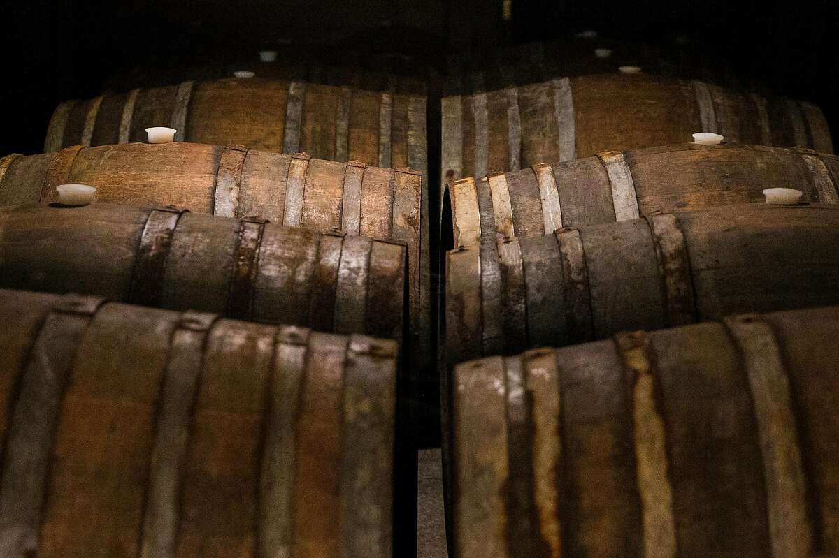 Original barrels of wine from the 1940s sit in a cellar at Stony Hill Vineyard in Calistoga, Calif. Tuesday, Aug. 21, 2018.
