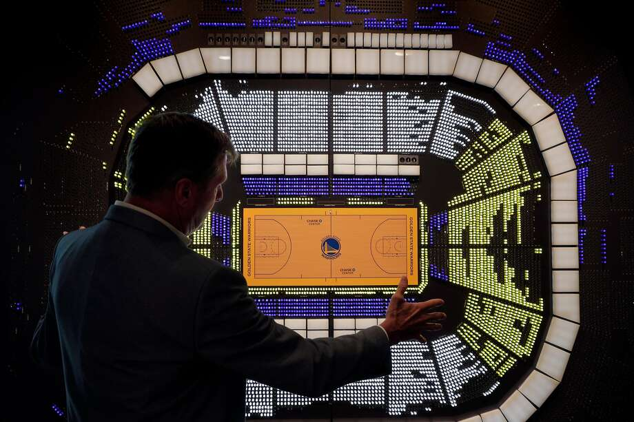 Warriors President and Chief Operating Officer Rick Welts looks at a rendering of seats in the arena at the new Chase Center. Seats sold as season tickets are lighted. Photo: Carlos Avila Gonzalez / The Chronicle