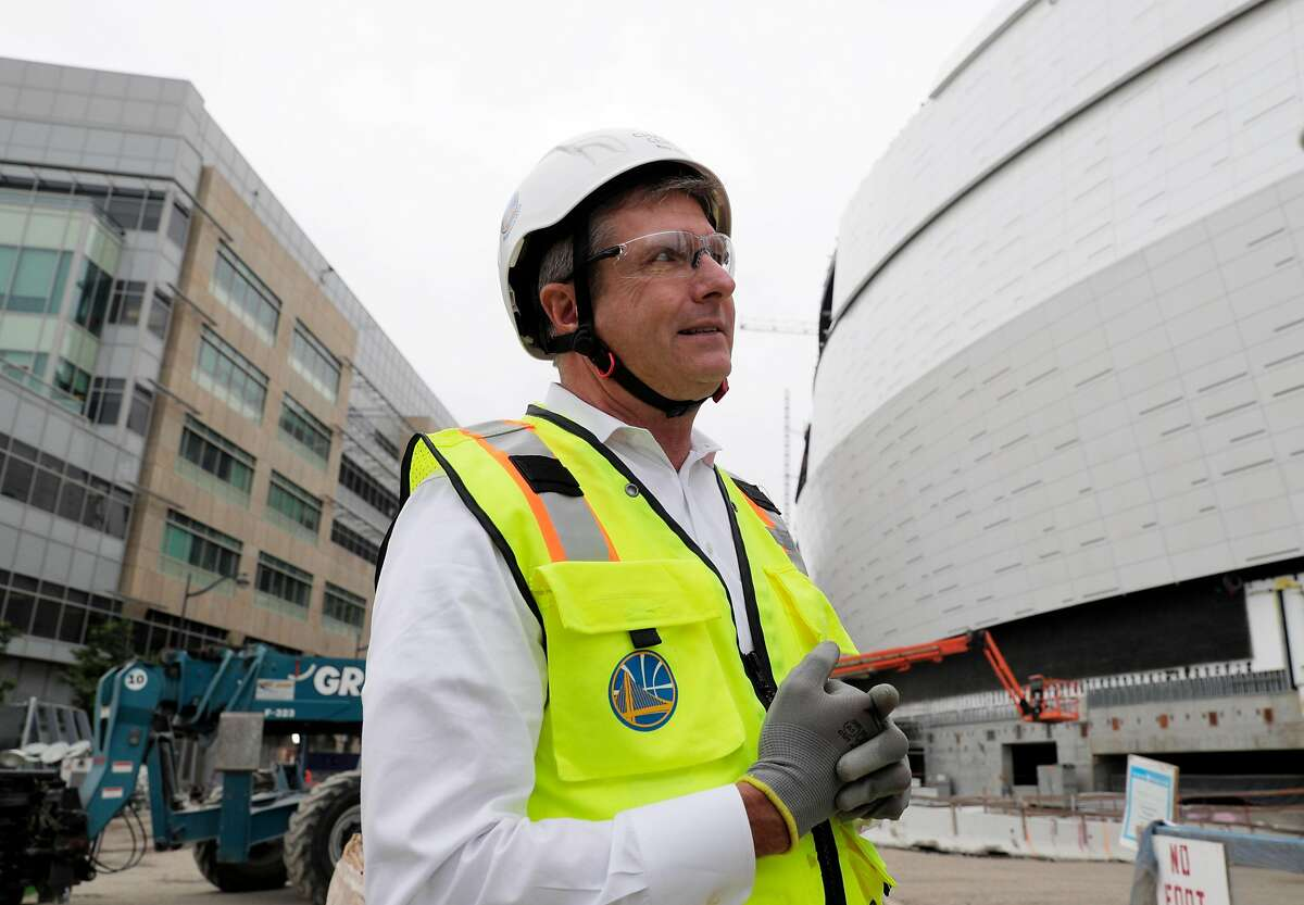 Warriors President and Chief Operating Officer Rick Welts walks by new exterior walls at the still-under-construction Chase Center in San Francisco, Calif., on Tuesday, August 21, 2018.