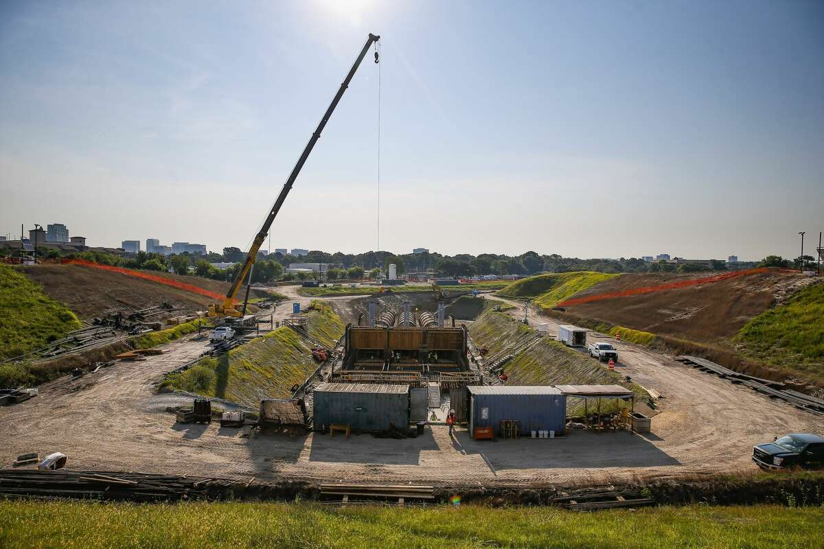 Construction crews work on the new outlet works at Barker Reservoir Thursday July 26, 2018 in Houston.