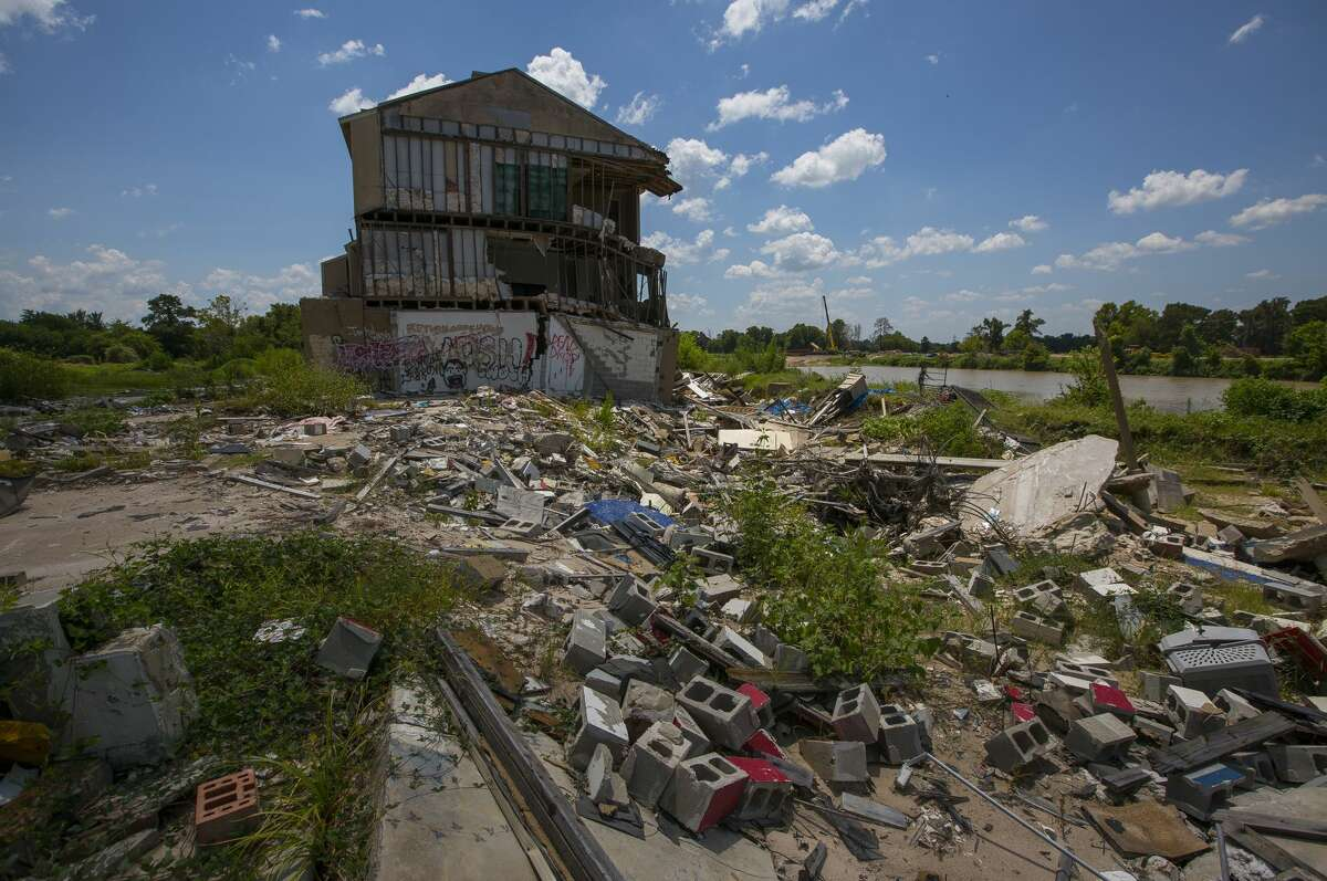 The Riverview at Forest Cove townhouse complex in the Kingwood area, destroyed by floodwaters from Hurricane Harvey, sits abandoned along the West Fork of the San Jacinto River east of Highway 59, Wednesday, Aug. 1, 2018 in Humble.