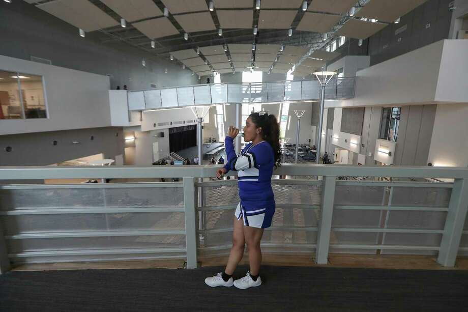 High School For Law and Justice cheerleader, Tanya Sanchez, sophomore, takes a break from giving tours during a preview of the new school Thursday, Aug. 23, 2018, in Houston. Photo: Steve Gonzales, Staff Photographer / Staff Photographer / © 2018 Houston Chronicle