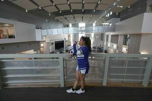 High School For Law and Justice cheerleader, Tanya Sanchez, sophomore, takes a break from giving tours during a preview of the new school Thursday, Aug. 23, 2018, in Houston.