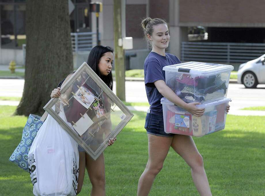 "Teah Renzi, 17, left, of Newtown, gets help from her friend Shay Sullivan moving her stuff into her daughter room at Litchfield Hall Friday, August 24, 2018. Freshmen students at Western Connecticut State University move into dorm rooms on the midtown campus in Danbury, Friday, August 24, 2018. The move-in is followed by the tradional ""entering the gates"" ceremony. Photo: Carol Kaliff / Hearst Connecticut Media / The News-Times"