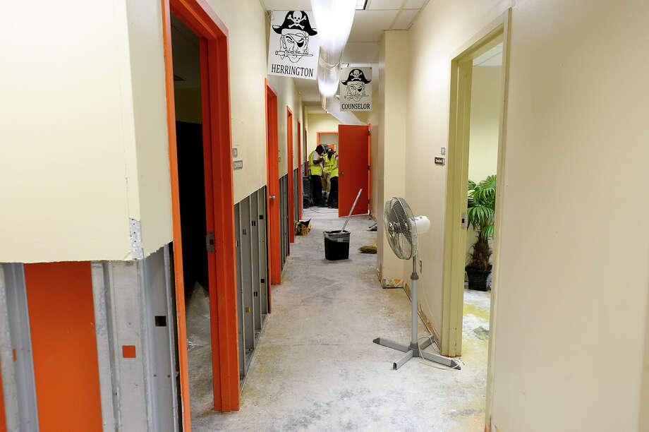 Flooded drywall has been removed in a hallway at Vidor Middle School on Thursday 9/14/17. Click through to see how Harvey damaged other SE Texas schools Photo: Ryan Pelham/The Enterprise / ?2017 The Beaumont Enterprise/Ryan Pelham