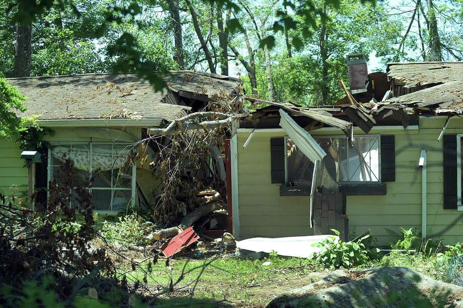 A home on Allen Road in Brookfield where a tree fell right down the center. The Federal Emergency Management Agency, Brookfield officials and U.S. Rep. Elizabeth Esty toured areas of Brookfield Monday, June 11, 2018, most heavily damaged by last month's macroburst. Photo: Carol Kaliff / Hearst Connecticut Media / The News-Times