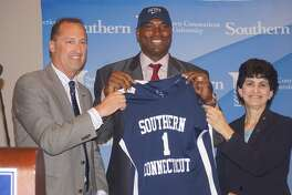 Head coach Scott Burrell, center, and the Southern Connecticut State men's basketball team will face UConn in an exhibition game on Nov. 2.