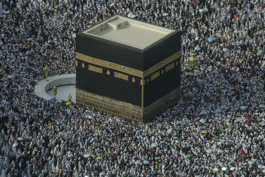 Muslim pilgrims perform the farewell circling of the Kaaba, the cubic building at the Grand Mosque, marking the end of hajj pilgrimage in the Muslim holy city of Mecca, Saudi Arabia, Thursday, Aug. 16, 2018. The annual Islamic pilgrimage draws millions of visitors each year, making it the largest yearly gathering of people in the world.(AP Photo/Dar Yasin) Photo: Dar Yasin / Associated Press / Copyright 2018 The Associated Press. All rights reserved.