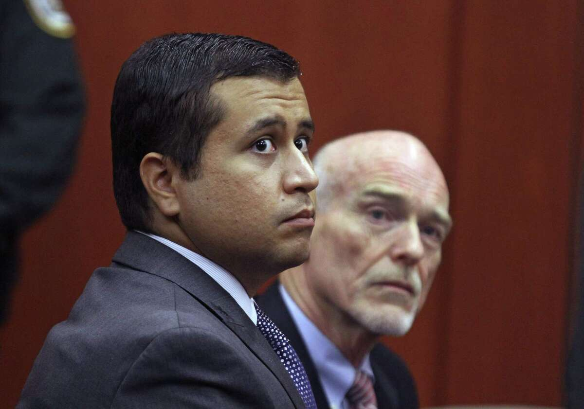 George Zimmerman, left, and attorney Don West appear before Circuit Judge Kenneth R. Lester, Jr., June 29, 2012, during a bond hearing at the Seminole County Criminal Justice Center in Sanford, Fla. Zimmerman was acquitted in the shooting death of Trayvon Martin in a case that resonated with racial bias.