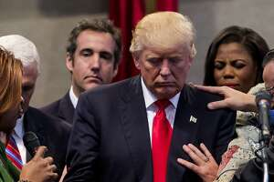 In friendlier days, Michael Cohen, behind Donald Trump on the left, at a campaign stop at the New Spirit Revival Center in Cleveland, Sept. 21, 2016. Cohen pleaded guilty to charges and implicating the president in criminal activity.