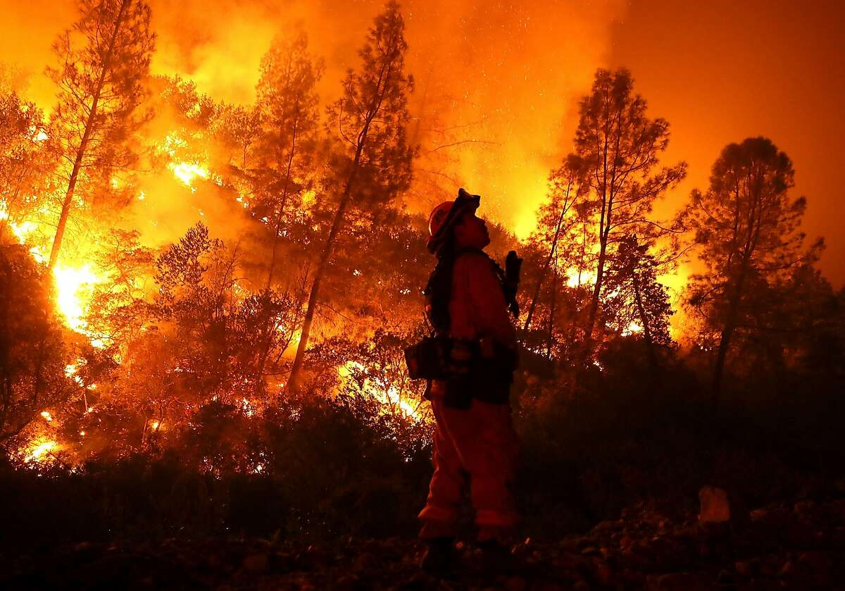 LODOGA, CA - AUGUST 07: A firefighter monitors a back fire while battling the Medocino Complex fire on August 7, 2018 near Lodoga, California. The Mendocino Complex Fire, which is made up of the River Fire and Ranch Fire, has surpassed the Thomas Fire to