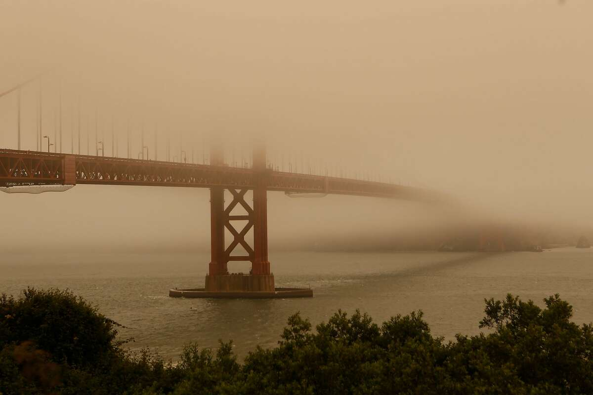 The Golden Gate Bridge is consumed in fog and smoke on Sunday, July 1, 2018 in San Francisco, Calif. Air quality in and around San Francisco has been visibly affected by the fires through the weekend.