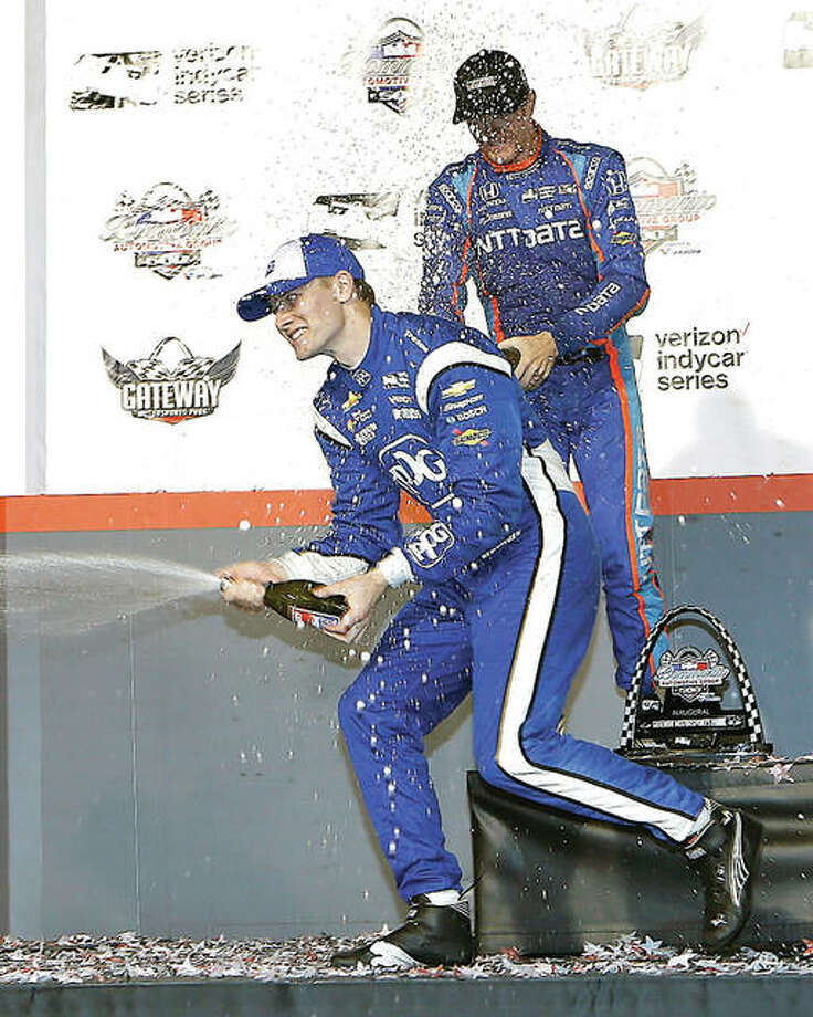 Josef Newgarden, front, celebrates his first-place finish along with second-place finisher Scott Dixon, of New Zealand, by spraying champaign after they receievd their awards following last year's IndyCar race at Gateway Motorsports Park in Madison. Photo: Scott Kane | AP Photo