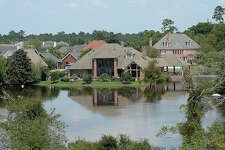 Areas throughout Orange County, including portions of a neighborhood west of Texas 62, remain underwater as water slowly recedes from last week's Tropical Storm Harvey historic and unprecedented rainfall. Photo taken Sunday, September 3, 2017 Kim Brent/The Enterprise