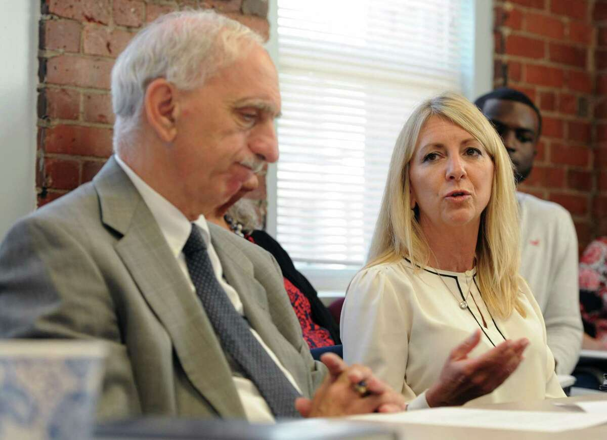 Optimus Health Care CEO Lud Spinelli listens as Jennifer Kolakowski, CEO at Recovery Networks of programs, speaks. makes a point to the crowd gathered at a roundtable discussion at the Kinsella Treatment Center in Bridgeport, Conn. on Friday, Aug. 24, 2018. U.S. Senator Chris Murphy (D-Conn.) and Miriam Delphin-Rittmon, Department of Mental Health & Addiction Services commissioner, held the meeting was to talk about the $10 million federal grant Connecticut received to help residents with addiction and mental health disorders.