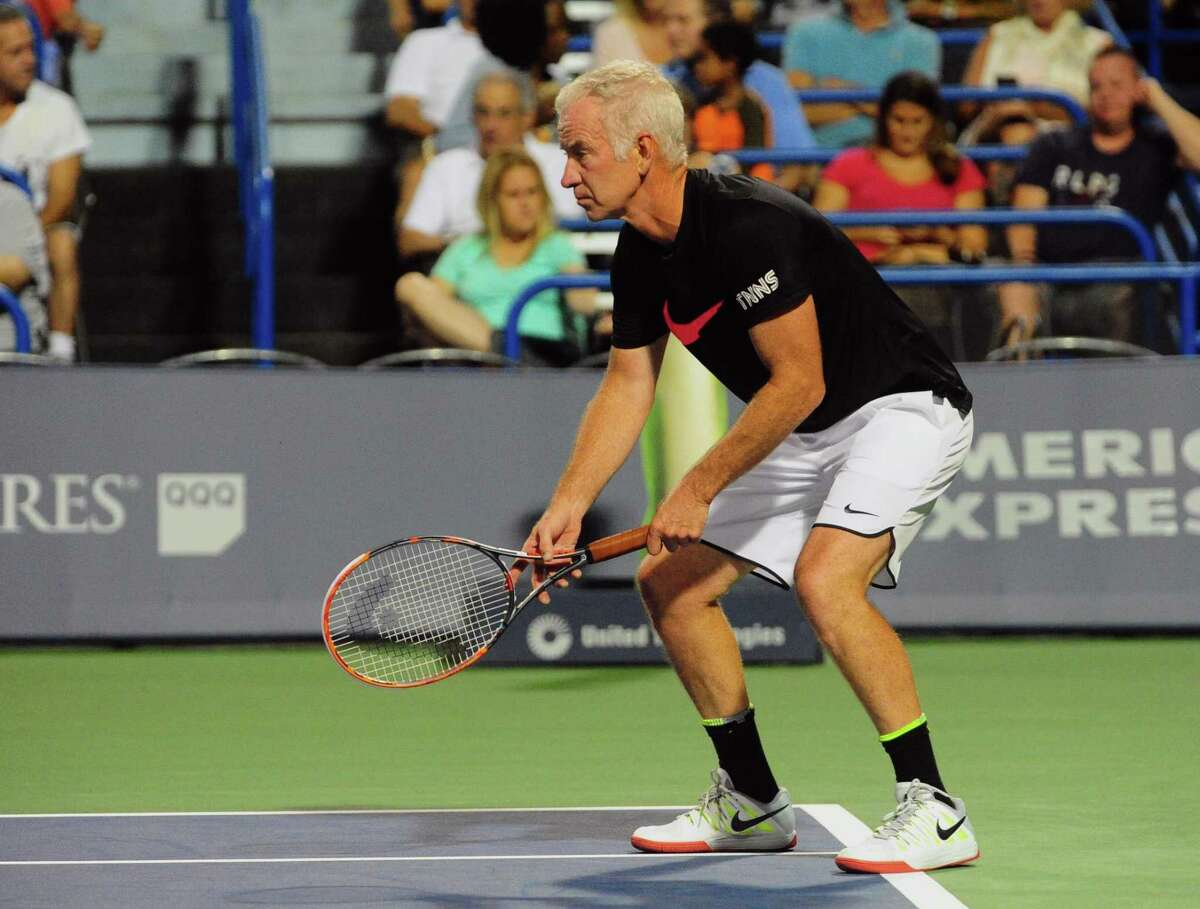 John McEnroe plays against James Blake in the men's Legends match during the 2016 Connecticut Open.