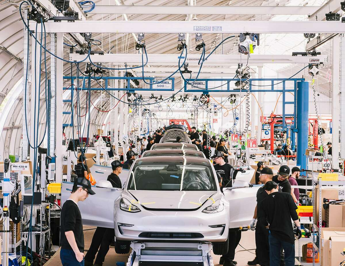 FILE � An assembly line at Tesla's Factory in Fremont, Calif., June 28, 2018. Elon Musk says he wants to take Tesla private, but removing a company with a market value of about $55 billion from the public market is no easy task. (Justin Kaneps/The New York Times)