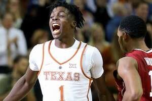 Texas guard Andrew Jones (1) celebrates as Oklahoma guard Jordan Woodard (10) walks off the court after the game Monday Jan. 23, 2017 at the Frank Erwin Center in Austin, Tx. Texas won 84-83.