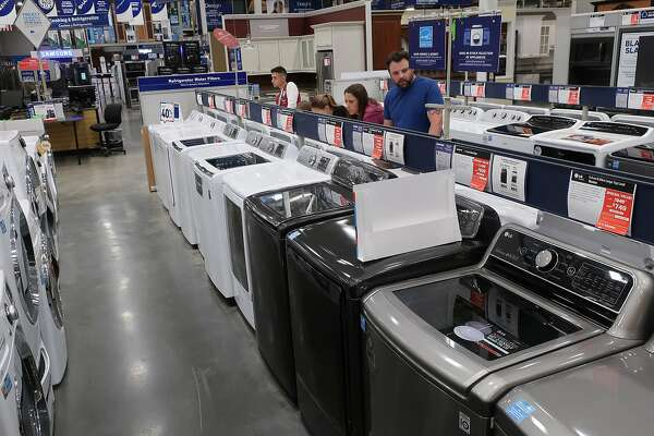 329e4ed4f34 1of42FILE- In this May 21, 2018, file photo, a family shops for washing and  drying machines at Lowe's Home Improvement store in East Rutherford, ...