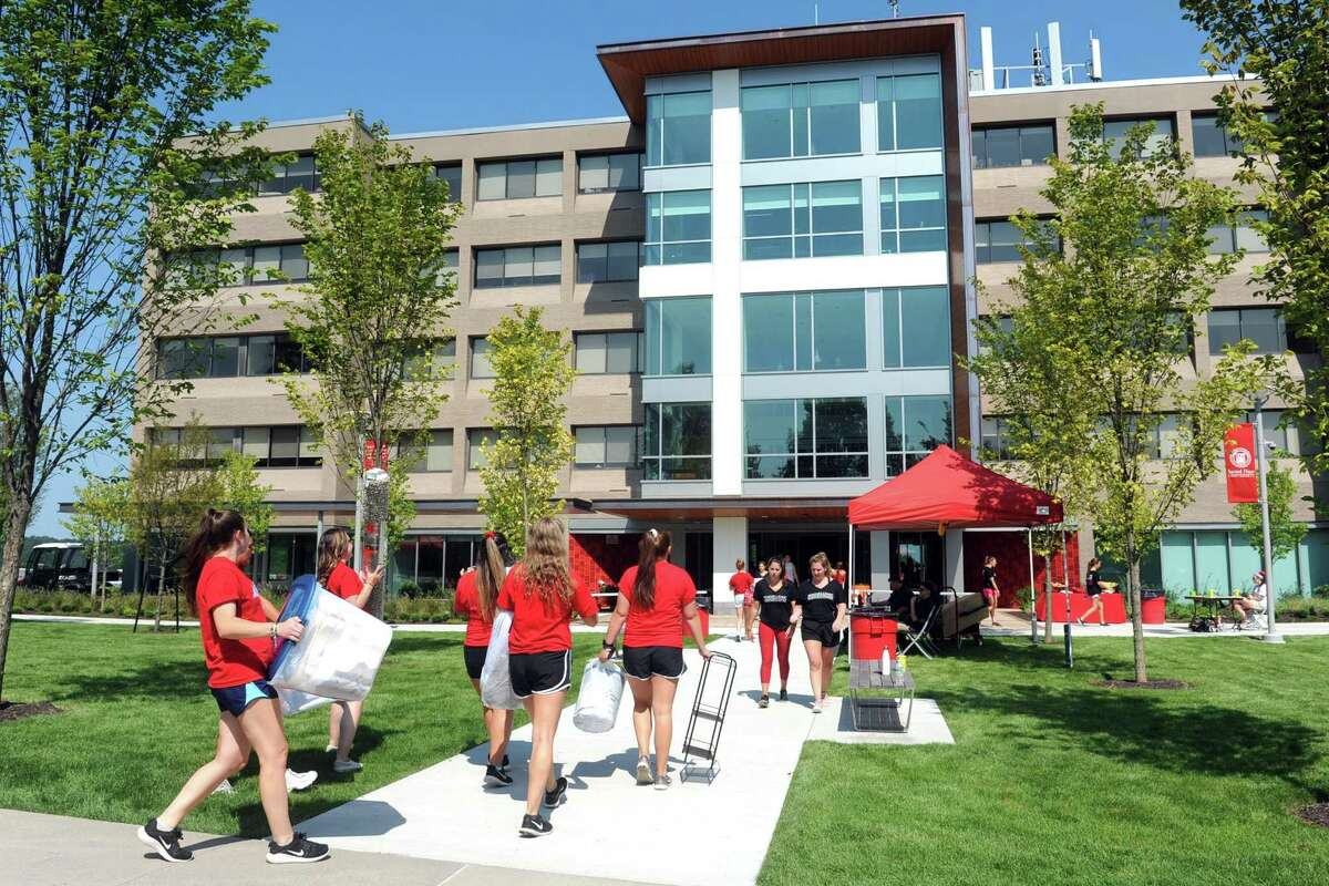 Students move into Toussaint Hall, the newly opened dormitory on the campus of Sacred Heart University in Fairfield on Friday.