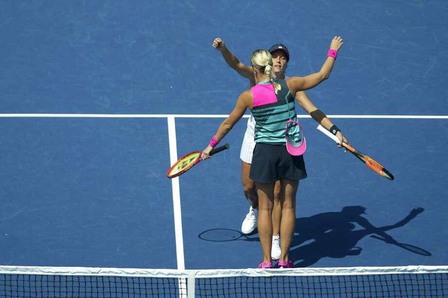 Andrea Sestini Hlavackova, front, hugs doubles teammate Barbora Strycova after defeating Alicja Rosolska and Abigail Spears in the semifinals of the 2018 Connecticut Open in New Haven, Conn. on Friday, Aug. 24, 2018. Sestini Hlavackova and Strycova won the match 3-6, 6-3, 12-10. Photo: Michael Cummo / Hearst Connecticut Media / Stamford Advocate