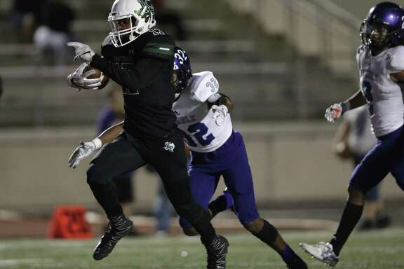 Kingwood Park Panthers running back Immanuel Mcelroy jr (17) rushes for a touchdown defended by Humble Wildcats Joe Nevis (32) during the high school football game between the Humble Wildcats and the Kingwood Park Panthers in Humble, TX on Friday, November 10, 2017.