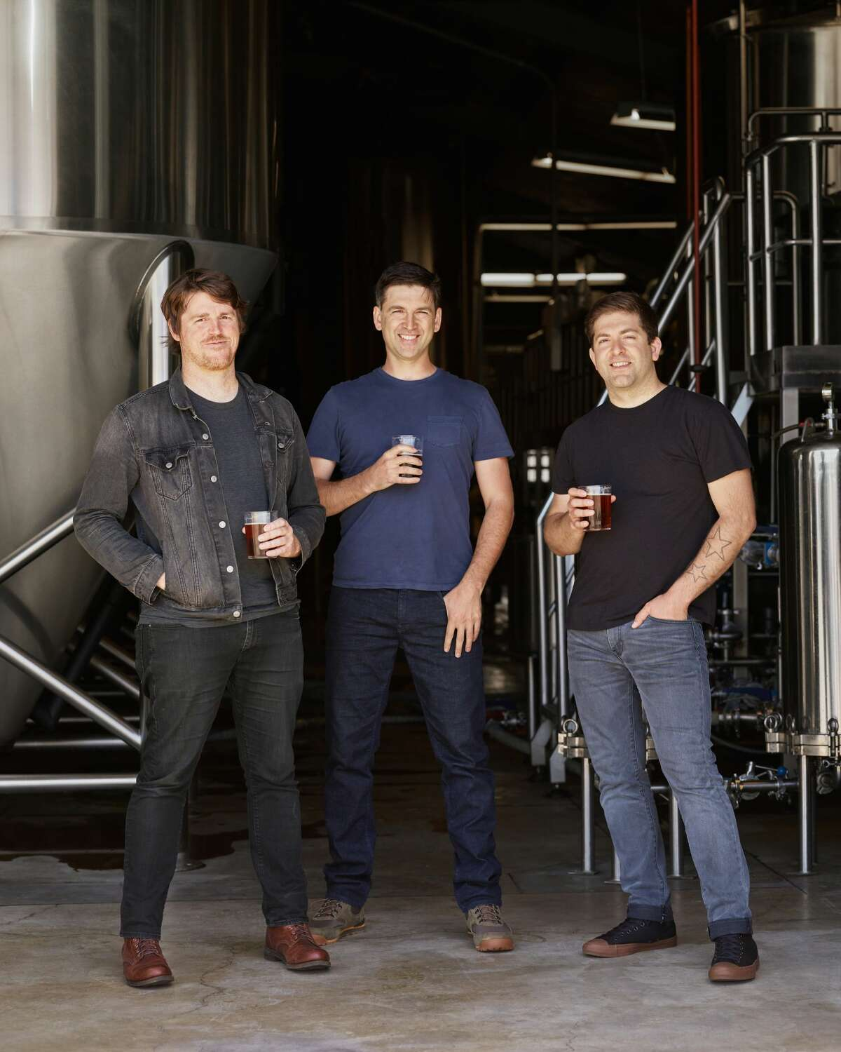 Pictured: (l-r) Fort Point brewmaster Mike Schnebeck and co-founders Tyler Catalana and Justin Catalana.