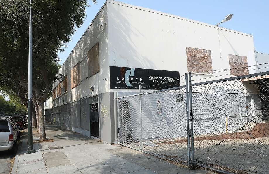 Housing construction at 2675 Folsom St., a vacant former restaurant equipment warehouse in the Mission District, is stalled amid soaring construction costs and other fees. Photo: Liz Hafalia / The Chronicle