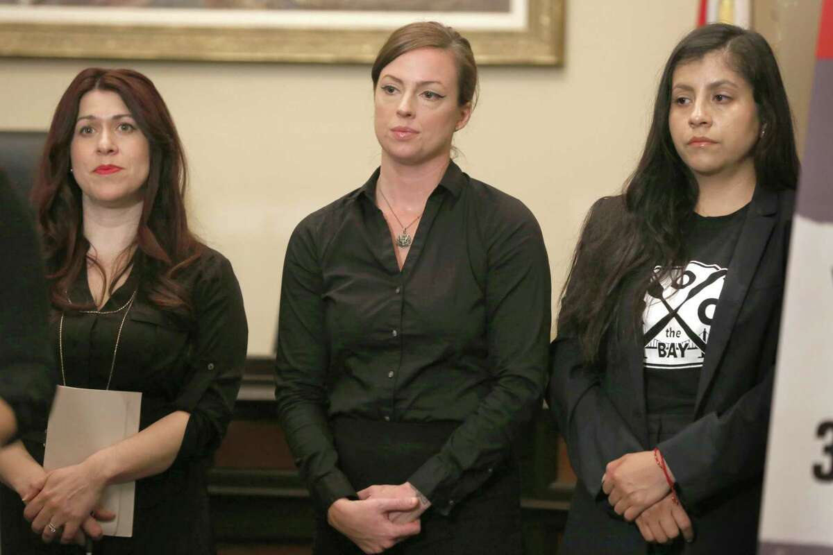 Victim of harassment Tara Zoumer (middle) seen during a press conference at the State Capitol on Wednesday, April 18. 2018, in Sacramento, Calif. Seeking to free sexual harassment victims from forced arbitration agreements that require maintained silence about what happened to them, the state Assembly is voting to subpoena victim to testify in open session.