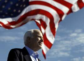 FILE - In this Nov. 3, 2008 file photo, Republican presidential candidate Sen. John McCain, R-Ariz. speaks at a rally outside Raymond James Stadium in Tampa, Fla. McCain's family says the Arizona senator has chosen to discontinue medical treatment for brain cancer.  (AP Photo/Carolyn Kaster))