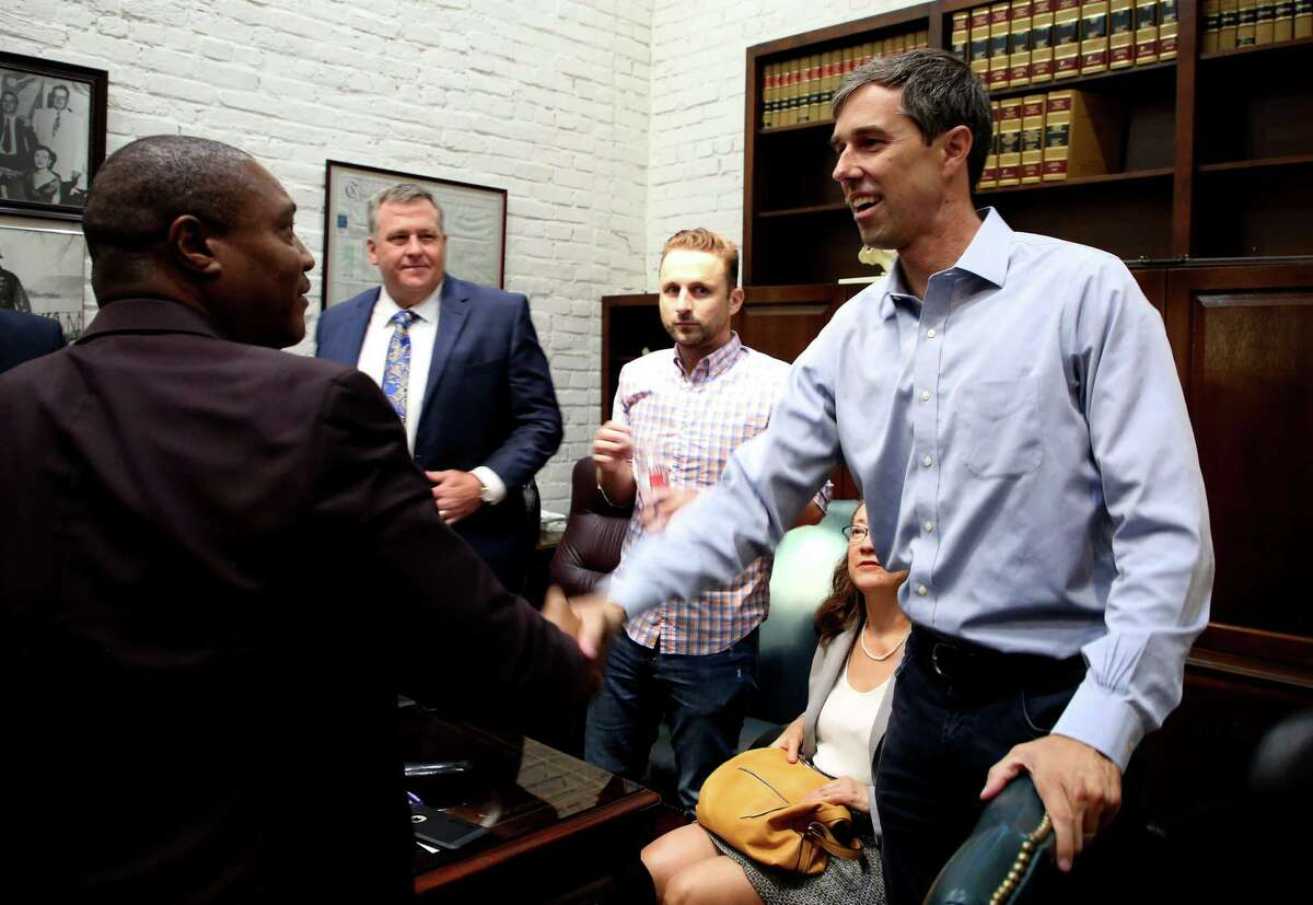 Texas Senate candidate Beto O'Rourke, right, shakes hands with Anthony Graves, who was wrongfully convicted 18 years for murder, Wednesday, Aug. 22, 2018, in Houston. O'Rourke met with local lawyers, activists, and academia for a roundtable discussion regarding overall criminal justice reform.