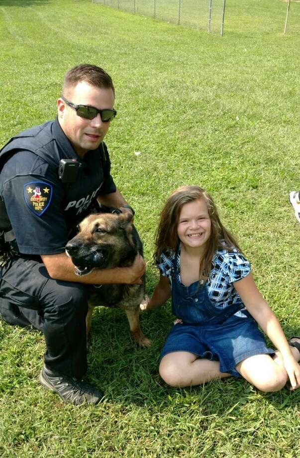 Troy Canine Officer Kyle Jones, K9 Blair and the located missing person. (Courtesy Troy Police Department)