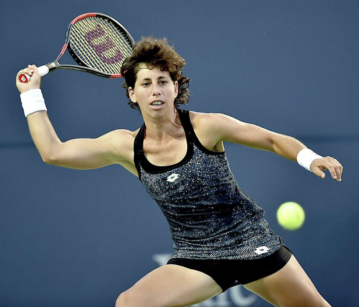 Carla Suarez Navarro returns a shot to Monica Puig during their semifinal match at the Connecticut Open on Friday.