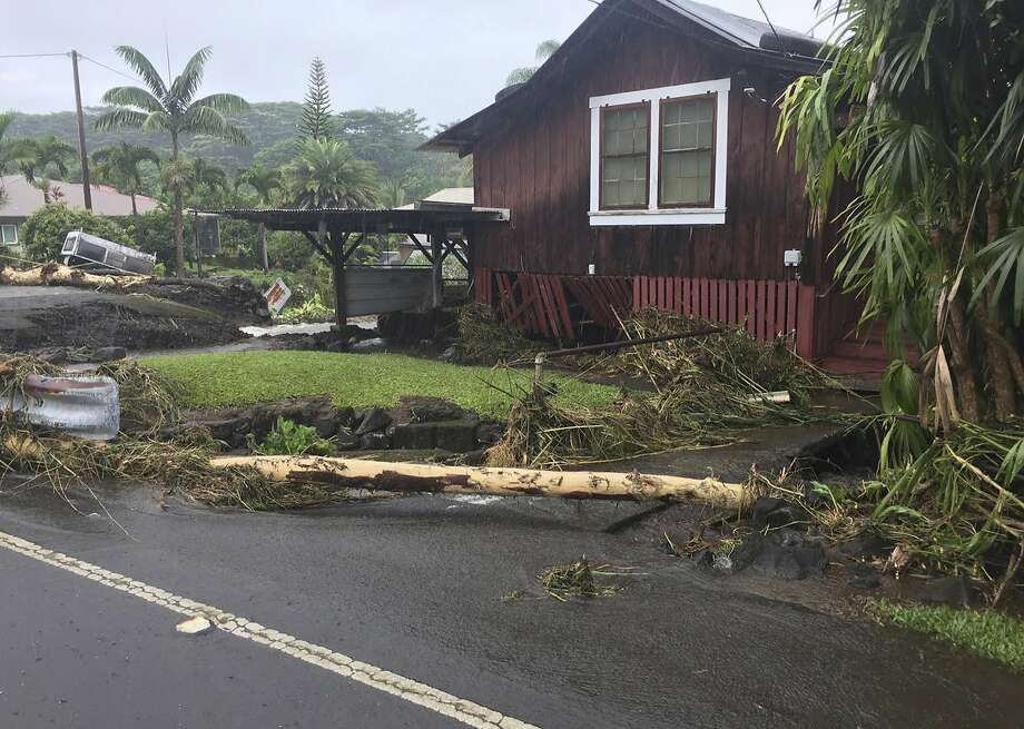 This photo provided by Jessica Henricks shows damage from Hurricane Lane Friday, Aug. 24, 2018, near Hilo, Hawaii. Hurricane Lane barreled toward Hawaii on Friday, dumping torrential rains that inundated the Big Island's main city as people elsewhere stocked up on supplies and piled sandbags to shield oceanfront businesses against the increasingly violent surf. The city of Hilo, population 43,000, was flooded with waist-high water. (Jessica Henricks via AP) Photo: Jessica Henricks, Associated Press