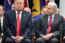 "(FILES) In this file photo taken on December 15, 201,7 US President Donald Trump (L) sits with Attorney General Jeff Sessions in Quantico, Virginia, before participating in the FBI National Academy graduation ceremony. - Trump tore into Sessions again on August 24, 2018, mocking him viciously a day after Sessions took the rare step of fighting back against criticism from the president. In a burst of early morning tweets, Trump quoted from a statement Sessions issued August 23, in what was seen as a veiled jab at Trump. ""'Department of Justice will not be improperly influenced by political considerations.' Jeff, this is GREAT, what everyone wants, so look into all of the corruption on the 'other side,' Trump wrote. (Photo by Nicholas Kamm / AFP)NICHOLAS KAMM/AFP/Getty Images"