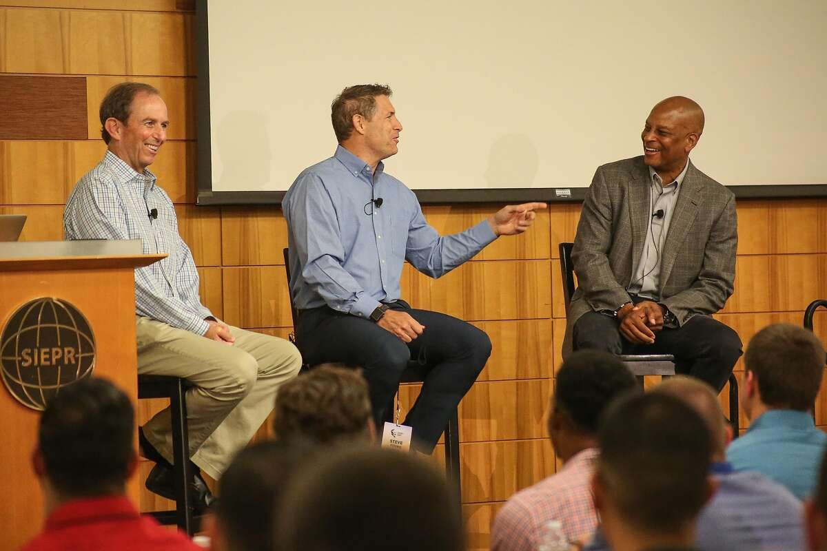 49ers legends Steve Young and Ronnie Lott advised recent graduates about transitioning from college football to the work place at the Campbell Summit on Friday.