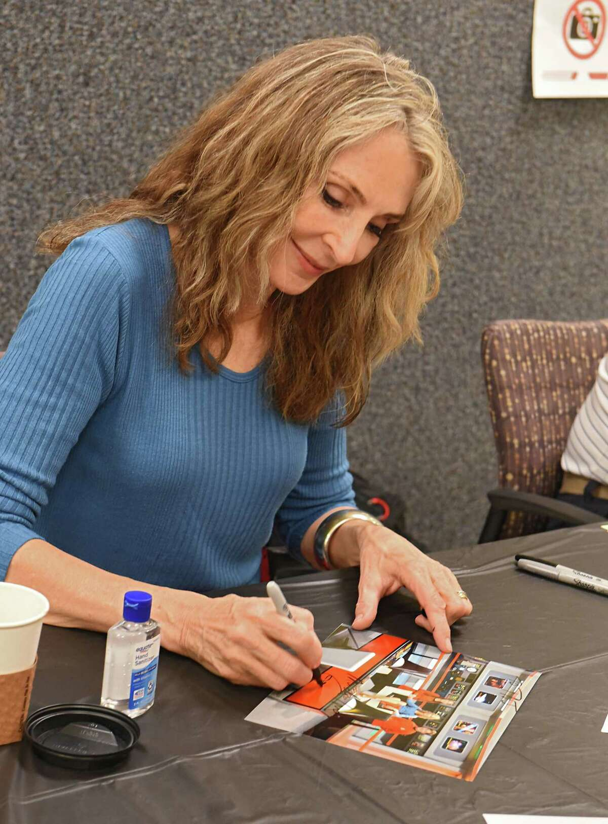 Gates McFadden, who played Dr. Beverly Crusher in the Star Trek Next Generation TV series, signs autographs for fans in the Ticonderoga High School gym during Trekonderoga 2018 on Friday, Aug. 24, 2018 in Ticonderoga, N.Y. (Lori Van Buren/Times Union)
